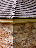 Slate roof with stone wall. Slate roofing with stone wall Stock Photos