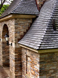 Slate roof with stone wall. And lamp Stock Photos