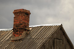 Slate roof of a village house with stove heating Royalty Free Stock Images