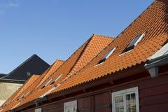 Slate roofing in Copenhagen. Red slate roofing of houses in Copenhagen, Denmark Stock Photo