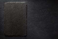 Slate signboard at black background Royalty Free Stock Photos