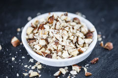 Slate slab with minced Hazelnuts Royalty Free Stock Photo