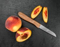 Slate slab with Peaches. Some Peaches on a vintage slate slab, selective focus Royalty Free Stock Images