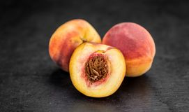 Slate slab with Peaches. Some Peaches on a vintage slate slab, selective focus Royalty Free Stock Photography