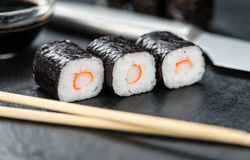 Slate slab with some Sushi (selective focus). Slate slab with some Sushi (selective focus; close-up shot Royalty Free Stock Images