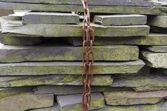 Slate slab stacked with chain. Stacks of slate slabs, with a chain hanging in front Royalty Free Stock Photography