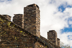 Slate stone fireplaces Stock Photography