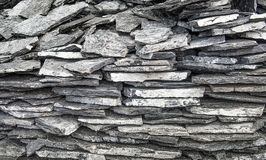 Slate stone wall Stock Images