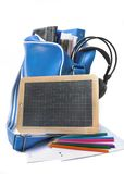 Slate with teen school supplies Royalty Free Stock Photos
