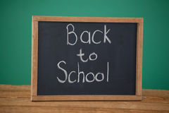 Slate with text back to school on table Royalty Free Stock Images