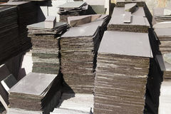 Slate tiles, stacked. Stacks of welsh roofing slates Royalty Free Stock Images
