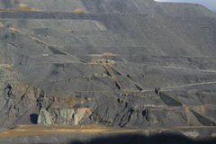 Slate tip. A hillside of slate waste from a quarry, winding houses and industrial inclines are situated on the hillside Stock Images