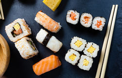 Slate tray of assorted sushi. Black slate tray of assorted sushi and rolls Stock Photo