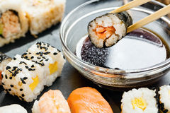 Slate tray of assorted sushi. Black slate tray of assorted sushi and rolls Royalty Free Stock Image