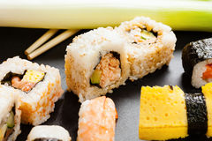 Slate tray of assorted sushi. Black slate tray of assorted sushi and rolls Stock Photography
