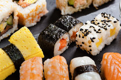 Slate tray of assorted sushi. Black slate tray of assorted sushi and rolls Stock Photos