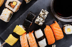Slate tray of assorted sushi. Black slate tray of assorted sushi and rolls Stock Image