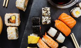Slate tray of assorted sushi. Black slate tray of assorted sushi and rolls Royalty Free Stock Photos