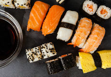 Slate tray of assorted sushi. Black slate tray of assorted sushi and rolls Royalty Free Stock Photo