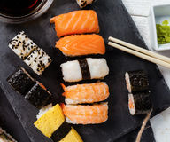 Slate tray of assorted sushi. Black slate tray of assorted sushi and rolls Royalty Free Stock Images