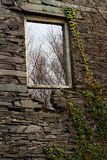Slate Window Frame. The window in the gable end of what was the main slate mill at the Dorothea Slate Quarry, This is in Nantlle, Gwynedd, Wales, United Kingdom Stock Photo