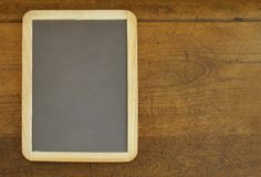 Slate on Wood Desk Stock Photo