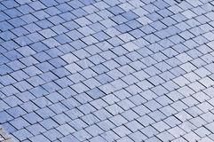 Slated rooftop. Photo of a house's roof with slates Stock Photo