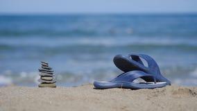 Slates lie on the sand on the beach Royalty Free Stock Photos