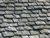 Slates on an old roof. Weathered slates on an ancient roof stock photos