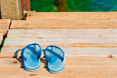 Slates on a wooden pier near the sea Royalty Free Stock Photography