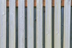 Slats of Bleached Fence. In front of gray wall Stock Photos