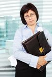 Slattern. Sloppy businesswoman with briefcase looking at camera Stock Photography