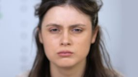 Slattern woman looking at camera, defocused vision after night party, hangover. Stock footage stock footage