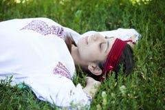 Slav girl at green meadow. Stock Image