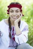 Slav girl at green meadow. Royalty Free Stock Photo