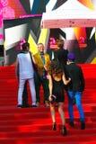 Slava Zaitsev at Moscow Film Festival. Fashion designer Slava Zaitsev (in yellow jacket, smiling) at XXXV Moscow International Film Festival red carpet closing stock photos
