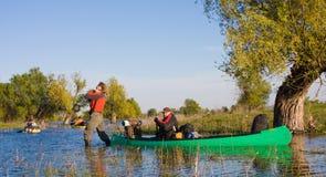 Slave dragging Canoe Stock Photo