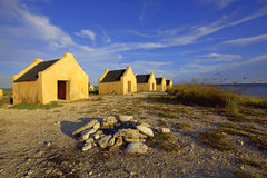 Slave huts. Historical yellow slave huts on Bonaire, Caribbean Stock Photos