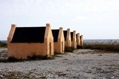 Slave huts on the island of Bonaire. Slave huts built in 1850 for the slaves on the island of Bonaire decorate the historical beach royalty free stock image