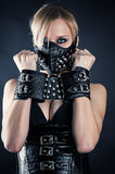 Slave in a mask with spikes. Woman slave in a mask with spikes Stock Photo