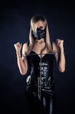 Slave in a mask with spikes. Woman slave in a mask with spikes Stock Image