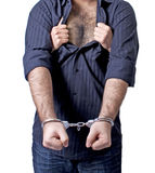 Slave to love. The hairy chest of a man is wide opened by a female Royalty Free Stock Photography