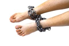 Slave woman leg tied up with steel chain on white background, Human rights violations, International Women`s Day stock image