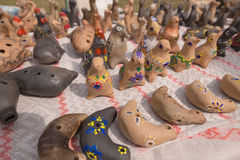 SLAVGOROD, BELARUS - AUGUST 14: Fair exhibition of handicrafts. Products made of clay. Whistles August 14, 2016 in Slavgorod, Bela Stock Images