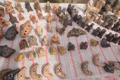 SLAVGOROD, BELARUS - AUGUST 14: Fair exhibition of handicrafts. Products made of clay. Whistles August 14, 2016 in Slavgorod, Bela Royalty Free Stock Photos
