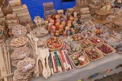 SLAVGOROD, BELARUS - AUGUST 14: Fair exhibition of handicrafts. Wood products. Matryoshka boxes spoon basket August 14, 2016 in Sl Stock Photo