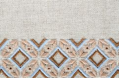 Slavic cross stitch by brown and beige threads. Stock Photos