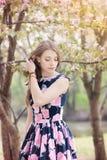 Slavic girl in spring in park. sakura blossom background Royalty Free Stock Photo