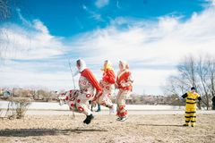 Slavic holiday of the end of winter. Happy girls jumping on a jump rope royalty free stock image