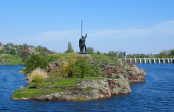 The slavic knight. Huge knight standing on the island and protecting the city Royalty Free Stock Photography